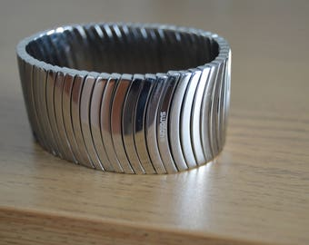 Swatch polished stainless steel armband,bracelet.Elastic connection.Collectibles.Rare.