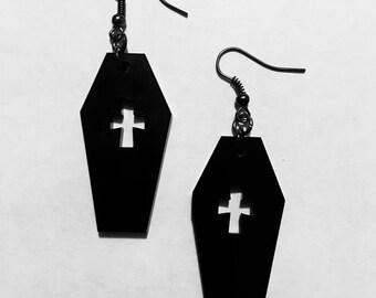 Black coffin, cross drop earrings.