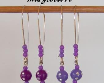 These earrings quite in lightness in purple tones