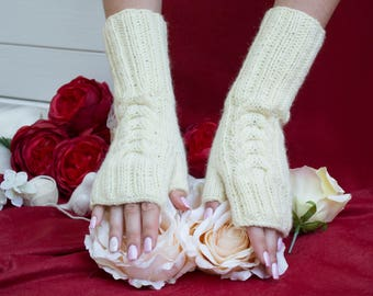 Hand-knitting. Warm and beautiful gloves without fingers -the best present for holidays and celebrations  for a woman.