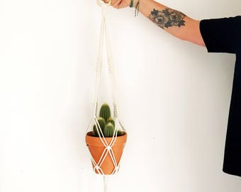 Plant hanger with wooden ring