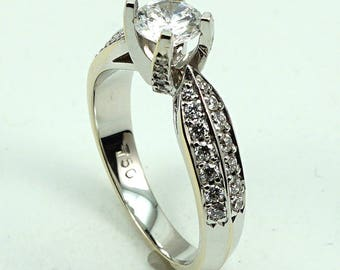 Engagement Ring 18K WG CZ Center Stone with 28-Diam Side Stones at 0.47 Cts.