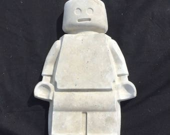 Concrete lego man