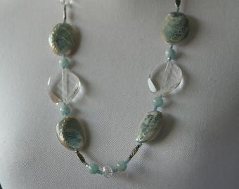Necklace with shells, aquamarine, crystal, light blue Swarovski crystals and silver.