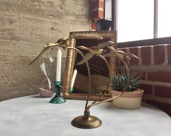 Vintage Brass duck in flight