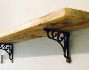 Reclaimed wood shelf with cast iron brackets