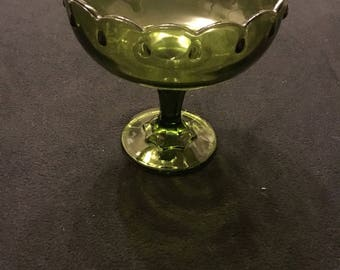 Green fruit bowl on pedistal