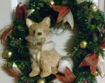 Adorable gold fox on an evergreen wreath perfect for Christmas