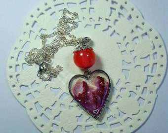 Necklace with UV resin pendant and dried flowers