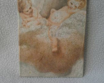 Picture made with the technique of decoupage, depicting two angels in the Clouds