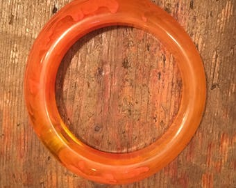 Vintage plastic orange swirl bangle 1980s