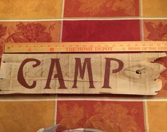 "Handmade from 100% reclaimed wood ""camp"" sign. Pre wired to hang. 21 1/2in long x 5 1/4in tall."