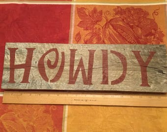 """Handmade 100% reclaimed """"howdy"""" sign. 17 3/4in long x 5 1/4in tall. Pre wired to be hung."""
