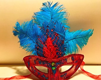 Nawlins, Mardi Gras, turquoise, red, masque, masquerade, ribbon tied, clear plastic, lace covered, festival, costume, accessory, party mask