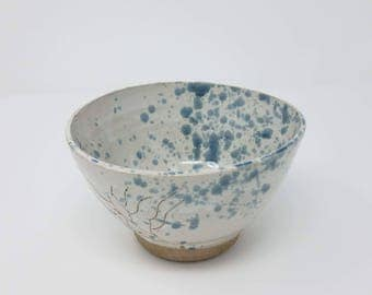 White bowl with blue splatter