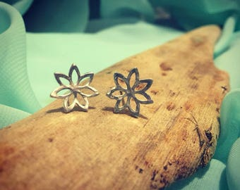 Handmade sterling silver hammered flower stud earrings.