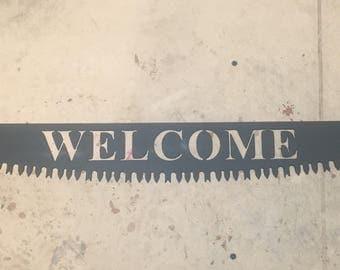 Mini crosscut saw welcome sign