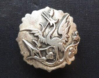 Heron metal button