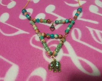 Handmade beaded necklace with elephant charm and colorful glass beads!