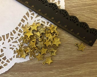 Lotto 28 gold-colored starlet pendants-Stars gold Charms