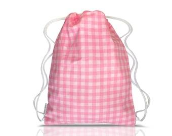 Child's pink gingham cotton draw string gym bag.