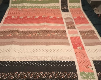 Striped quilt with offset design