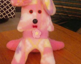 Puppy dog in pink multicolored print. Hypoallergenic stuffing. Safety eyes n nose. Pink collar. Measures 6 high.