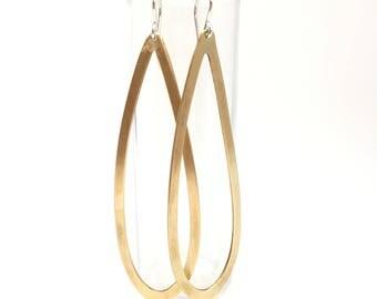 Elongated brass hoops