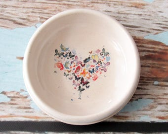 Butterfly heart ring bowl or tea bag holder, glazed in white with colorful butterfly art