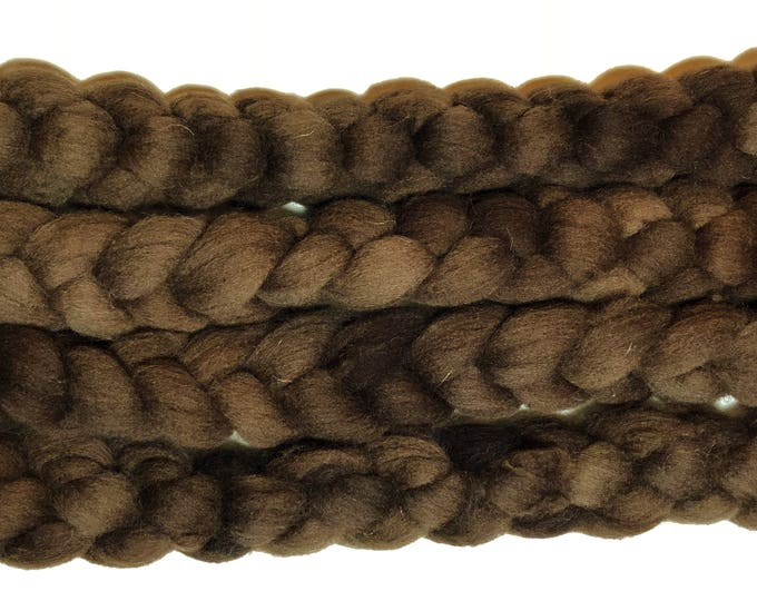Kettle dyed Cheviot wool top. Soft and easy to work with. Practically spins itself and great for felting. 4oz. braid. Teddy Bear