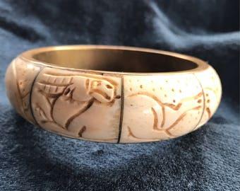 Carved bone and brass bangle bracelet