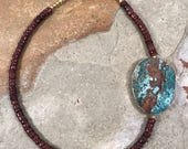 Asymmetric gold rimmed jasper slab and brown shell heishi necklace