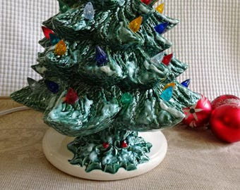 Ceramic 13 inch snowy Christmas tree  with optional music box in base - ready for shipping