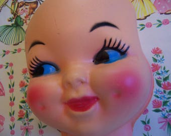 plastic doll head with dimples