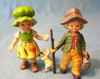 Vintage boy and girl figurines. marked Hong Kong made of hard plastic