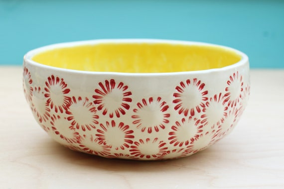 yellow and red stoneware bowl