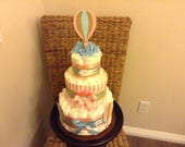 Custom hot air balloon diaper cake baby shower center pieces.