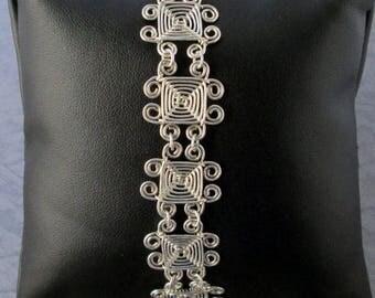 Hand Woven Sterling Silver Wire Bracelet, Scroll Ojos Bracelet