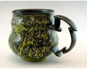 Etched Porcelain Mug With Splatter Design and Carved Handle