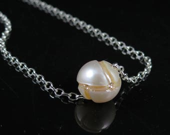 Carved pearl and CZ necklace