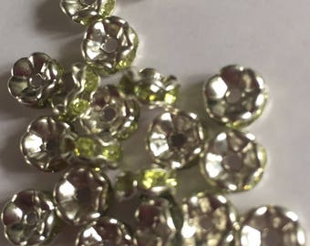 Set of 10 Grade A Green rhinestone spacer beads. 7x3mm