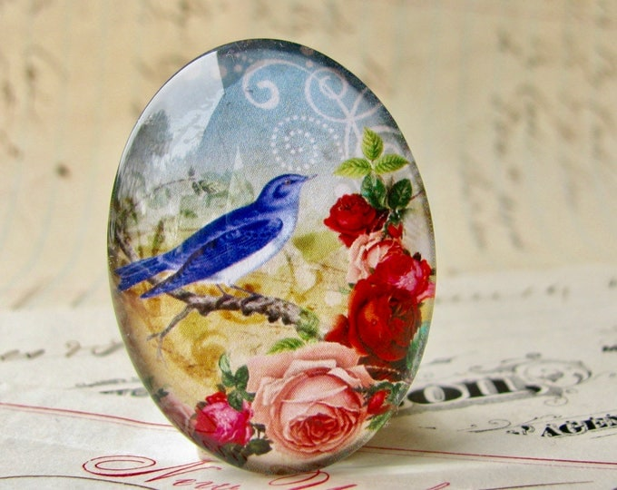 Bluebird with pink roses, from our Beautiful Birds collection of handmade glass cabochons, 40x30mm oval, pink flowers, made in this shop