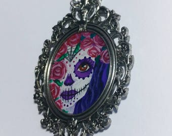 Hand painted day of the dead girl in ornate frame necklace. Dia de los muertos