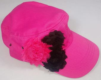 Hot pink army hat with hot pink and black flowers