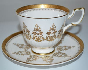 Tuscan cup and saucer gold floral pattern vintage English Bone China tea party