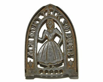 Vintage Amish Lady Iron Rest ., Iron Trivet - circa 1952