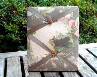 French Memory Board,  Floral cotton fabric over a solid wood frame, batting, satin ribbon with floral cabochons, easel back, peach, blue