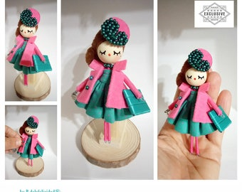 Brooch doll made and painted manually.