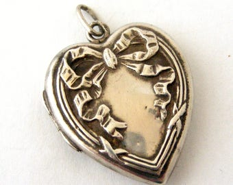 French art nouveau 800-900 silver heart locket with repousse ribbon design