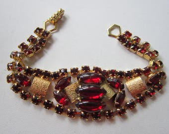 "Red Rhinestone BRACELET Textured Gold Tone  7 1/4""L   1 1/8"" W  Vintage 1950 Era Very good clean condition"